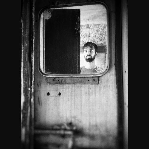 Portrait of girl looking through window