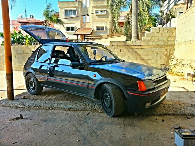 Peugeot GTI Racing Car 205 . getting ready for war ....