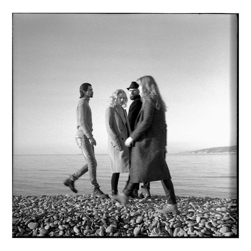 A series of black and white photos on the beach in a winter sunny day. Shooting by the sea. Portraits with natural light. Candid Authentic Moments Authentic Lifestyles Lifestyle Black And White Sea Togetherness Water Full Length Group Of People Beach Nature Horizon Land Sky People Horizon Over Water Females Men Bonding Emotion Adult Positive Emotion Human Relationship