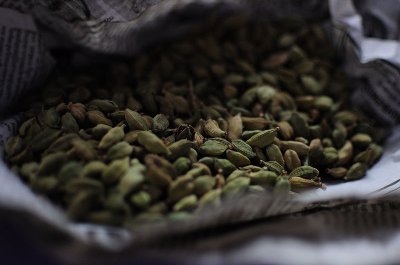 Close-up of cardamoms in paper bag