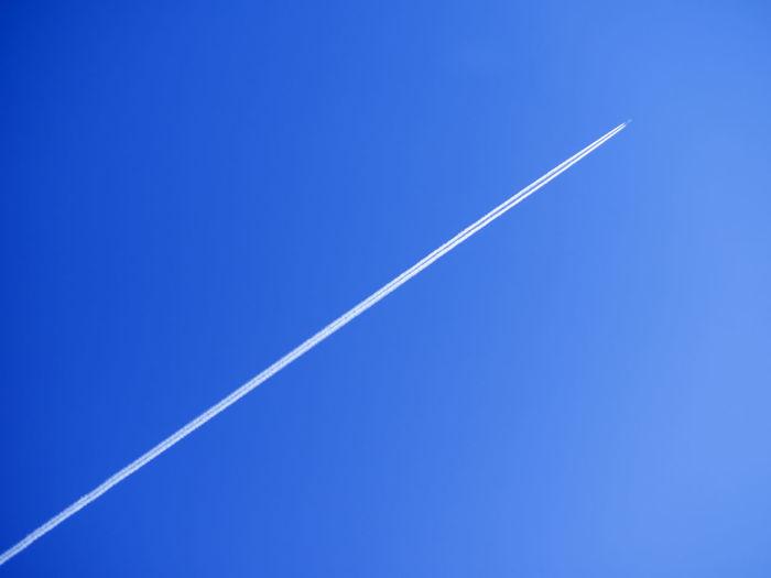 Vapor trail against clear blue sky