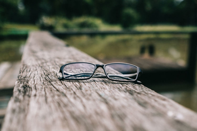 Absence Bench Close-up Day Eyeglasses  Eyewear Fashion Focus On Foreground Glasses Nature No People Outdoors Personal Accessory Plant Seat Selective Focus Still Life Sunglasses Surface Level Table Tree Wood - Material