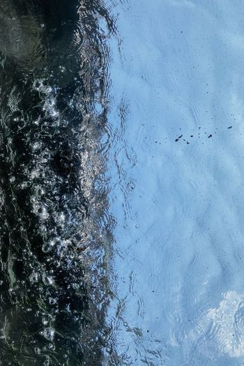 High angle view of snow on lake against sky