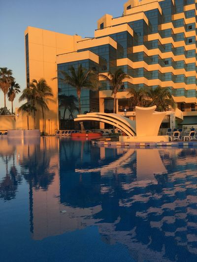 Reflejo Architecture Reflection Building Exterior Water Built Structure Modern The Graphic City Sunset Outdoors Swimming Pool No People City Sky Day
