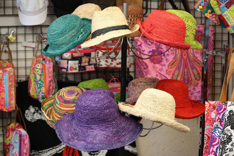 Various multi colored hats in store for sale at market stall