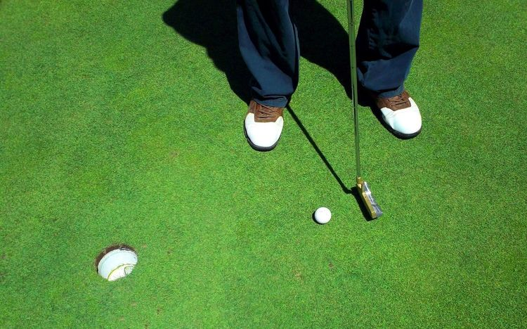 Putting for birdie on golf green Activity Close To Golf Golf Ball Golf Club Golf Course Golf Shoe Grass Green - Golf Course Green Color Hole Leisure Activity Men One Man Only One Person Outdoors Professional Sport Putting Putting Green Shoe Skill  Sport Standing Summer Taking A Shot - Sport Fresh On Market 2017