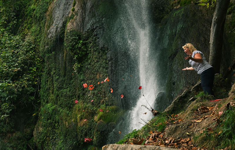 Amazed Adult Autumn Autumn Colors Autumn Leaves Beauty Beauty In Nature Day Fall Fall Colors Fall Leaves Horizontal Motion Nature One Person One Woman Only Only Women Outdoors People Person PlayfullMood Stream - Flowing Water Water Waterfall Young Adult