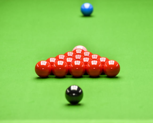 Close-up of red ball on table