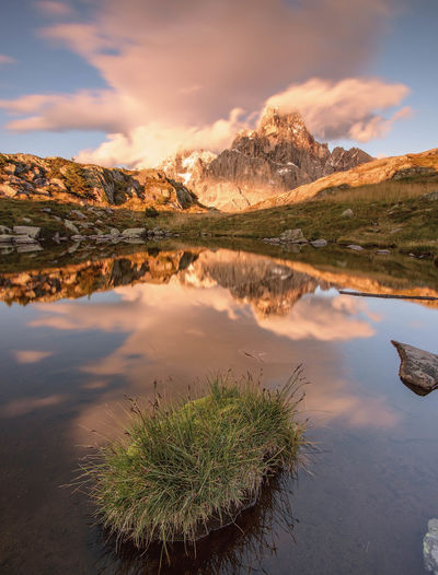 || Softness || Reflection Sunset Scenics Mountain Landscape Water Cloud - Sky Nature Lake Sky Outdoors Dawn Gold Colored Beauty In Nature No People Day Light Travel Destinations Colors Tranquility Dolomites, Italy Trentino Alto Adige Passo Rolle