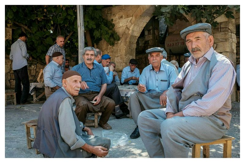 drinking cay and eating fresh fig Colour Streetphotography Travel Photography The Human Condition at Sehir Merkezi , Adiyaman in Turkey