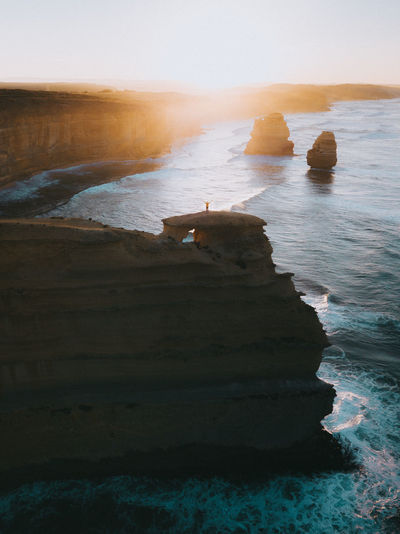 Sea Water Rock Beauty In Nature Scenics - Nature Land Beach Rock - Object Tranquility Tranquil Scene Solid Wave Nature Rock Formation Sky Horizon Over Water Stack Rock Ocean Aerial View Sunrise Australia Drone  Escaping Adventure