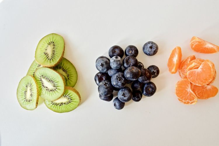 EyeEm Selects Fruit Freshness Blueberry Food Variation Healthy Eating No People Sweet Food Indoors  Close-up Day White Background Tasty😋 Healthy Lifestyle Food Photography Blueberries Multi Colored Mandarine Fruit Photography Kiwi - Fruit Ready-to-eat Tangerine Healthy Food Fruits