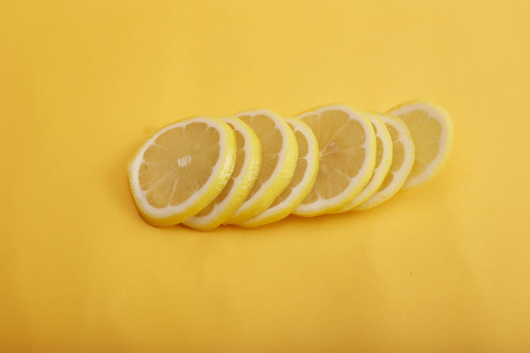 Sliced lemon isolated on color background Food Food And Drink Yellow Citrus Fruit Healthy Eating Still Life Indoors  Freshness Studio Shot SLICE Wellbeing Fruit No People Close-up Colored Background Yellow Background Cross Section Single Object Copy Space Cut Out Orange Vegetarian Food