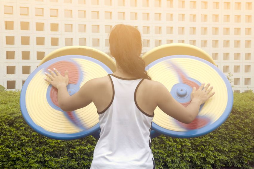 Woman exercise with hand wheel. Exercise Tempo Celerity Day Exercise Equipment Exercise Place Female Hand Leisure Activity Lifestyles One Person Outdoors Park People Quickness Rapidity Real People Speed Speediness Sport Wheel Of Fortune Young Adult