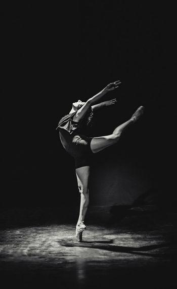 Full length of ballet dancer practicing in dance studio
