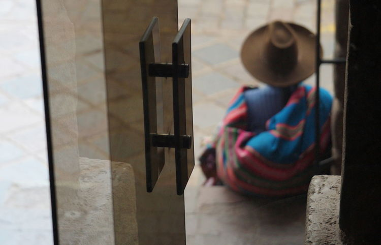 Chola Cusco, Peru Door Focus On Foreground Hat Multi Colored Reflection Woman Back Woman Sitting Connected By Travel