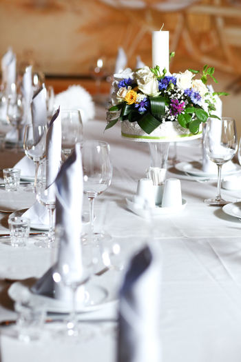 Bouquet of flowers on the banquet table Banquet Bouquet Centerpiece Day Dishes Flower Flower Arrangement Glasses Indoors  No People Place Setting Setting The Table Table Tablecloth Wineglass