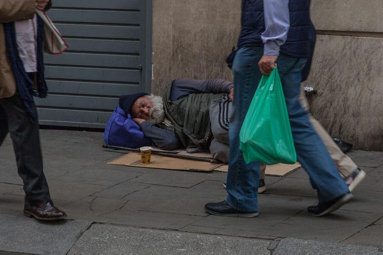 Poor  Sidewalk Adult Bag City Emotion Empathy Footpath Homless Hopelessness Hurry Men Plastic Bag Sleeping Social Issues Street The Street Photographer - 2018 EyeEm Awards