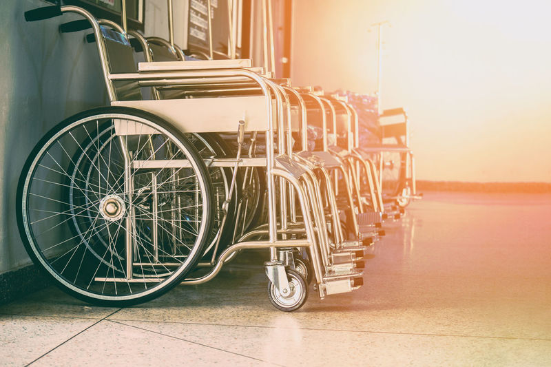 Hospital Architecture Built Structure Cart City Day In A Row Land Vehicle Luggage Cart  Metal Mode Of Transportation Nature No People Orange Color Outdoors Parking Lot Street Sunlight Transportation Travel Wheel