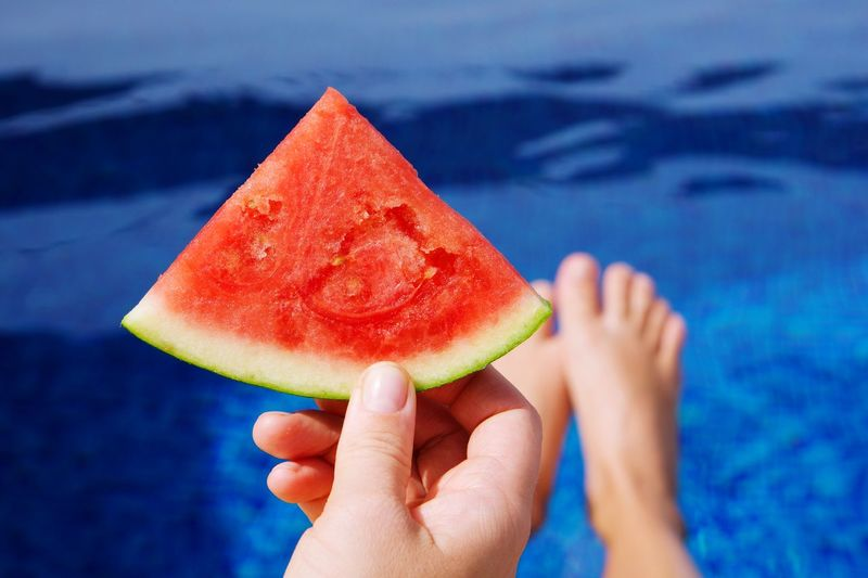 Watermelon slice by the pool Summertime Summer Food Refreshment Pool Time Watermelon Human Hand Human Body Part Healthy Eating Hand Food Fruit Watermelon Food And Drink Freshness Wellbeing Healthy Lifestyle Melon