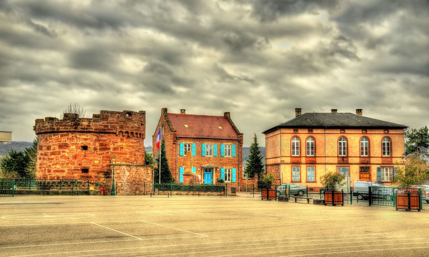 Houses against dramatic sky