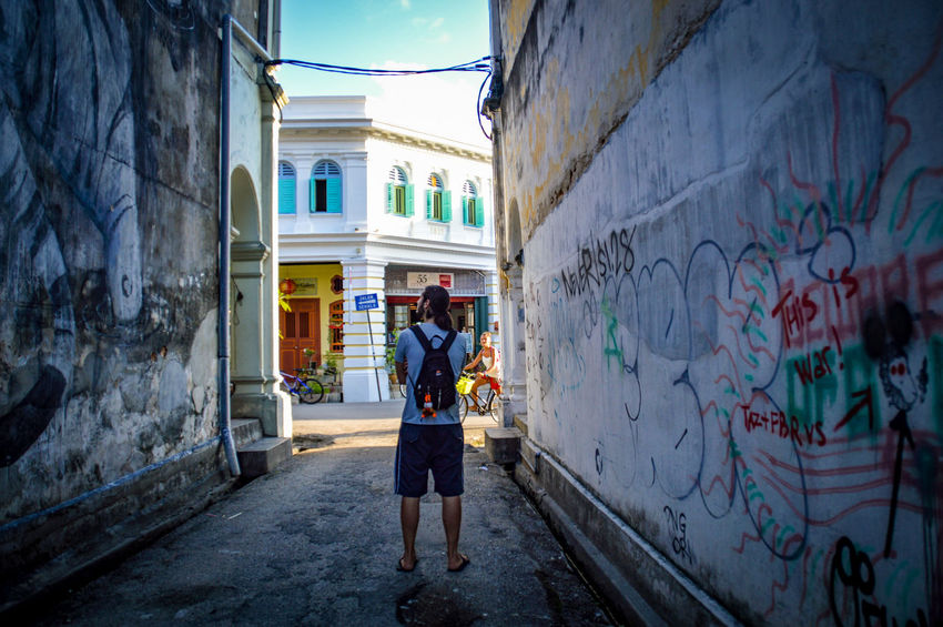 Shadows Alley In Between BuildingsStreets Of Penang In Between The Week On EyeEm Street Photography Penang Malaysia Travel Destinations One Person Watching Exploring The City Eyeem Philippines Done That.