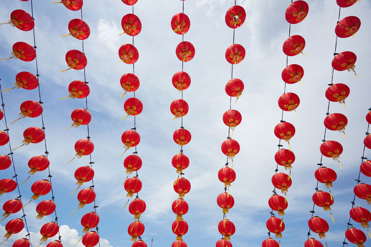 Low angle view of chinese lanterns hanging against sky