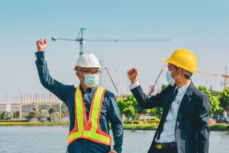 Men standing at construction site