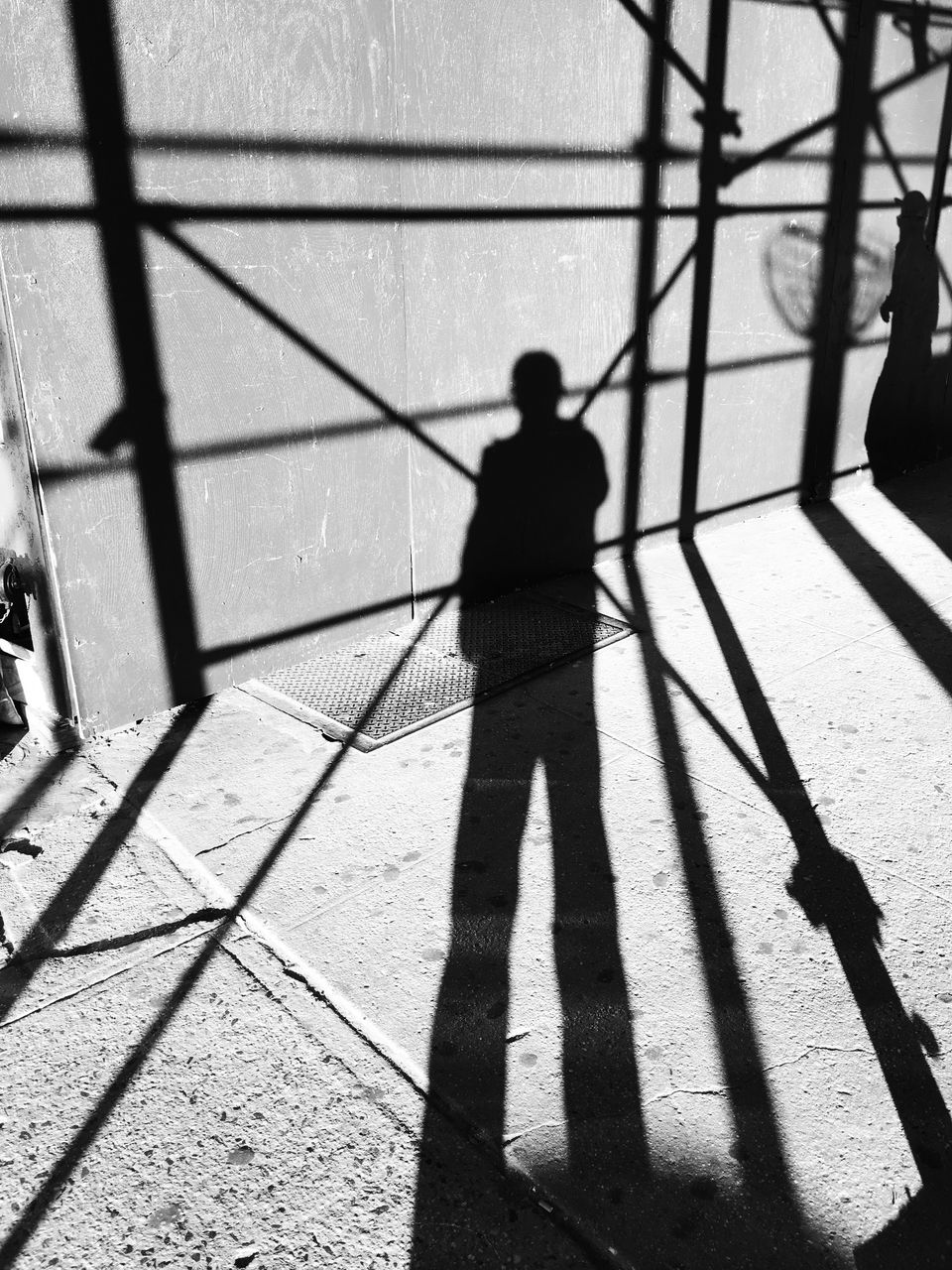 shadow, sunlight, real people, focus on shadow, one person, day, standing, high angle view, lifestyles, men, outdoors, people