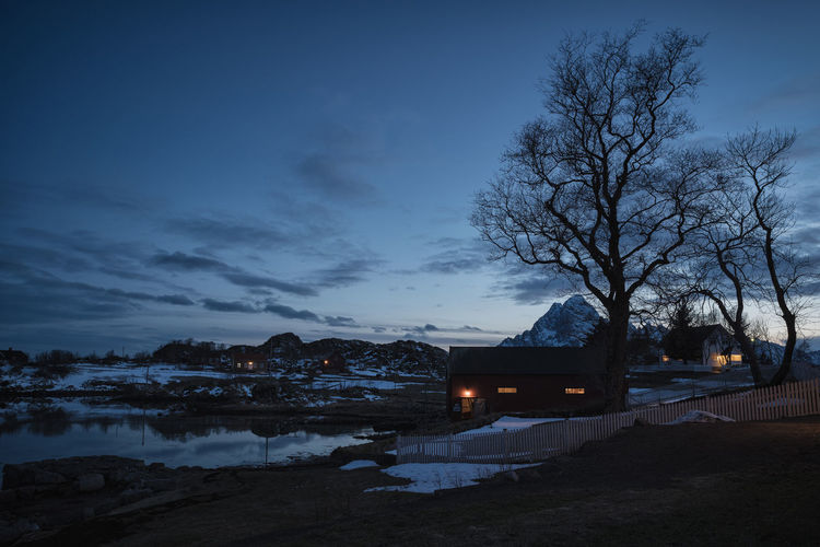 Blue Hour EyeEm Best Shots Fishing Village Moody Sky Norge Norway Beauty In Nature Blue Sky Boathouse Lake Lofoten Moody Lights Mountain Place To Visit Trees And Sky Village Life Village View