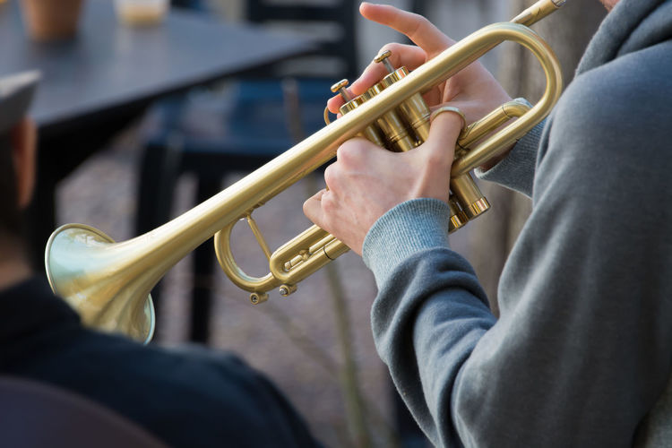 Close-up of person holding musical instrument
