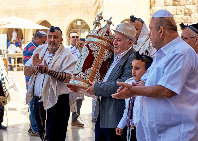 Bar Mitzah Casual Clothing Culture Event Jerusalem Leisure Activity Lifestyles Mask - Disguise Performance Performer  Person Sculpture Sitting Togetherness Traditional Clothing Young Adult An Eye For Travel