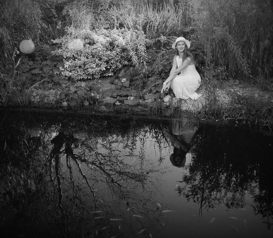 Reflection Tree Water One Woman Only Nature Outdoors Beauty In Nature Women Day Garden Whitehat Whitedress Lake Mirror Lake Goldfische Fishes Black&white EyEmNewHere Schwimmteich EyeEmNewHere