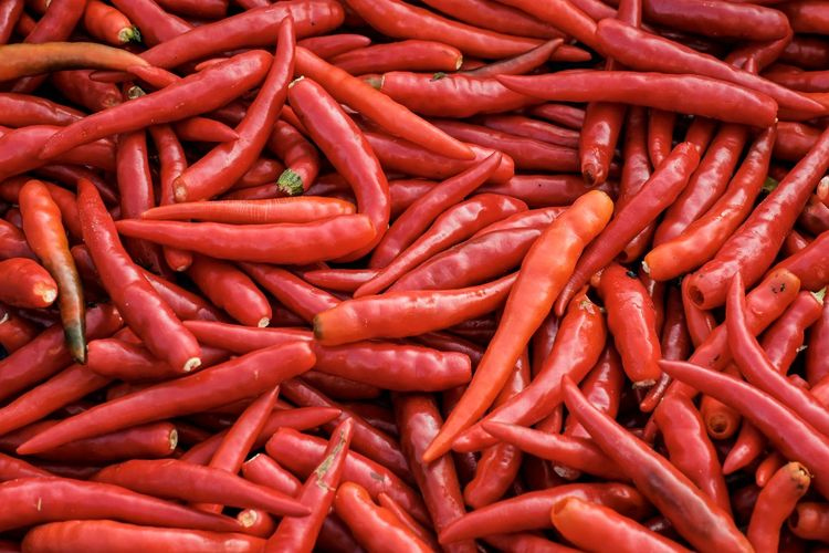 Full frame shot of red chili peppers at market