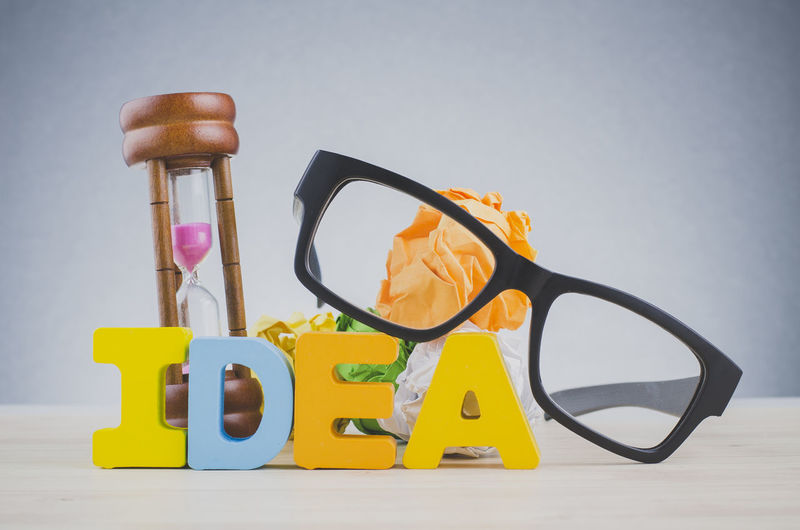 Alphabet word IDEA on wooden desk over dark background Still Life Studio Shot Indoors  No People Wood - Material Table White Background Close-up Yellow Cut Out Letter Colored Background Gray Choice Instrument Of Measurement Arrangement Large Group Of Objects Gray Background Accuracy Toy Blue Background