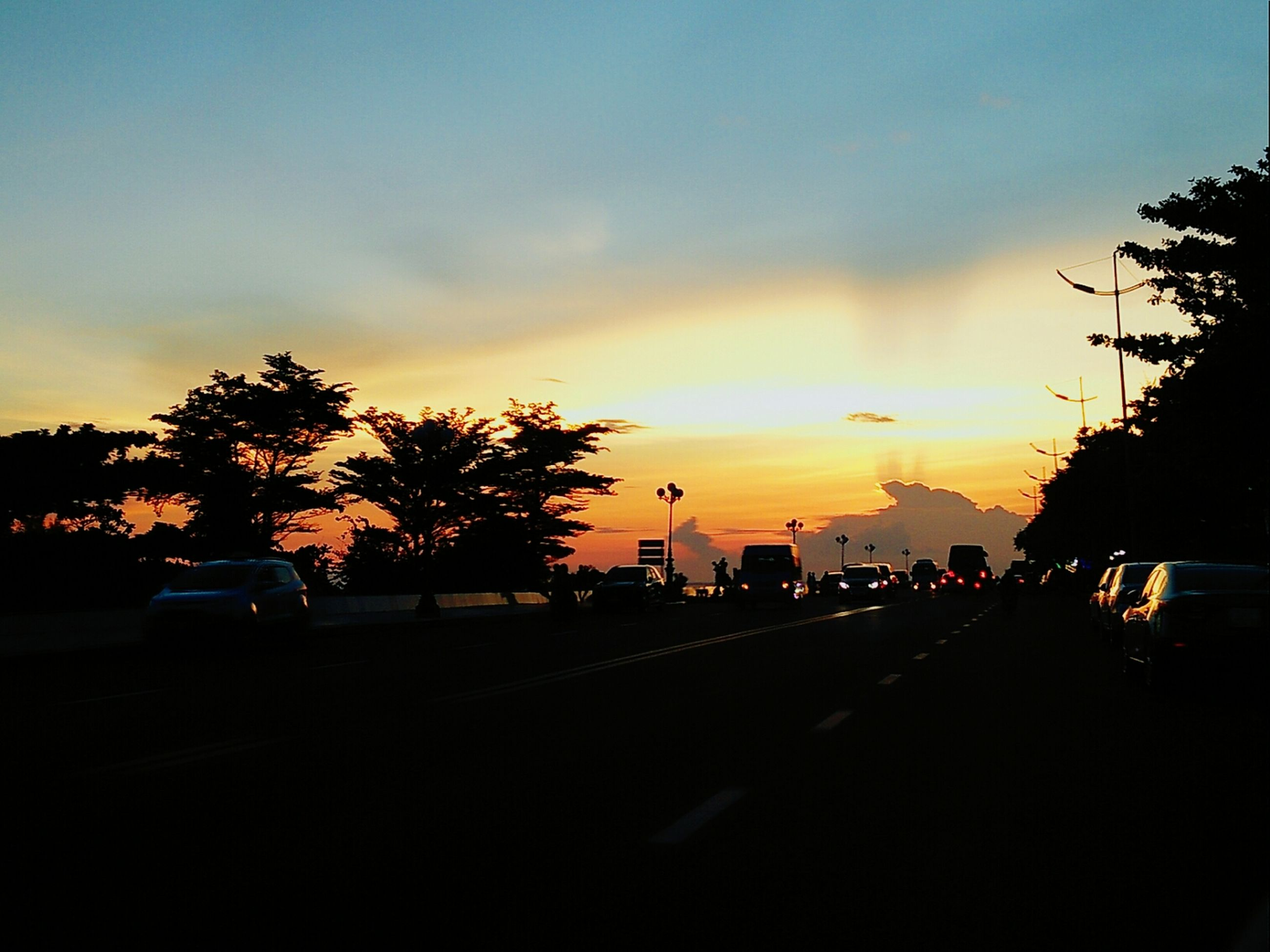 sunset, car, land vehicle, silhouette, traffic, tree, transportation, road, sky, city, no people, nature, outdoors