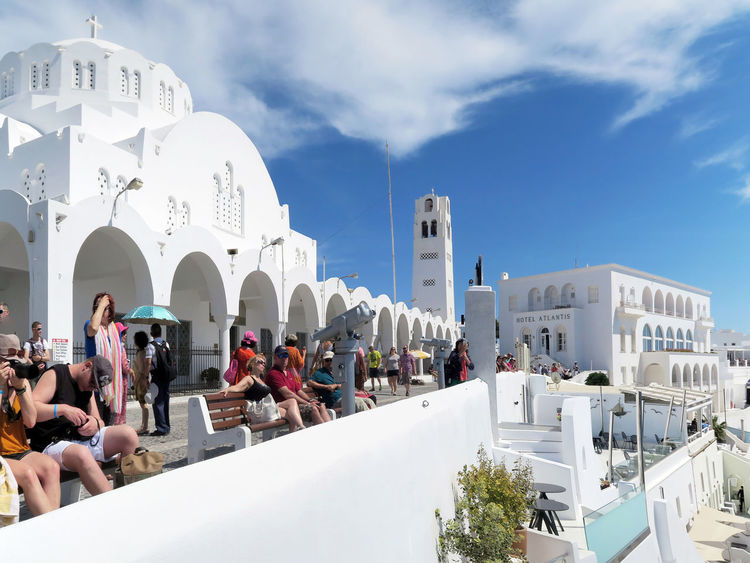 Fira, Santorini / GREECE May 15 2017: People resting on Promenade of Fira at Santorini (Greece) and enjoying the view over the caldera. made of 3 images Architecture Building Exterior Built Structure Church City Crowd Fira Santorini Large Group Of People Lifestyles Outdoors People Place Of Worship Real People Religion Santorini Santorini Greece Santorini Island Santorini View Santorini, Greece Spirituality Travel Destinations