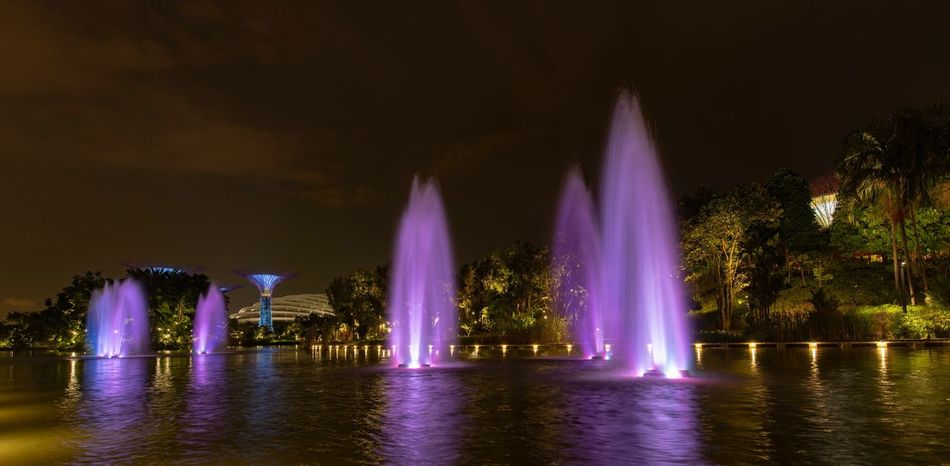 Gardens by the Sea Springbrunnen Water Night Architecture Illuminated Built Structure Waterfront Building Exterior Fountain Sky No People Travel Destinations River Reflection City Spraying Nature Tree Motion Outdoors Purple HUAWEI Photo Award: After Dark