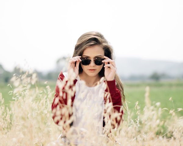 Field Front View Real People Young Adult Young Women Nature Leisure Activity One Person Lifestyles Outdoors Grass Looking At Camera Portrait Standing Clear Sky Day Plant Women Beauty In Nature Sky