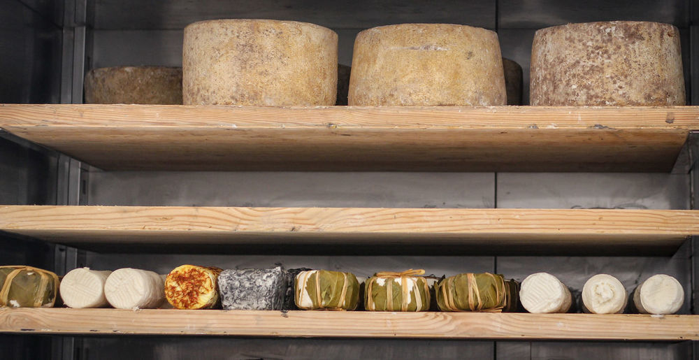 Special cheeses in boutique cheese factory b.s Abundance Arrangement Choice Collection Container Food And Drink In A Row Indoors  Large Group Of Objects No People Order Retail  Retail Display Shelf Shelves Side By Side Stack Still Life Store Variation Wood - Material