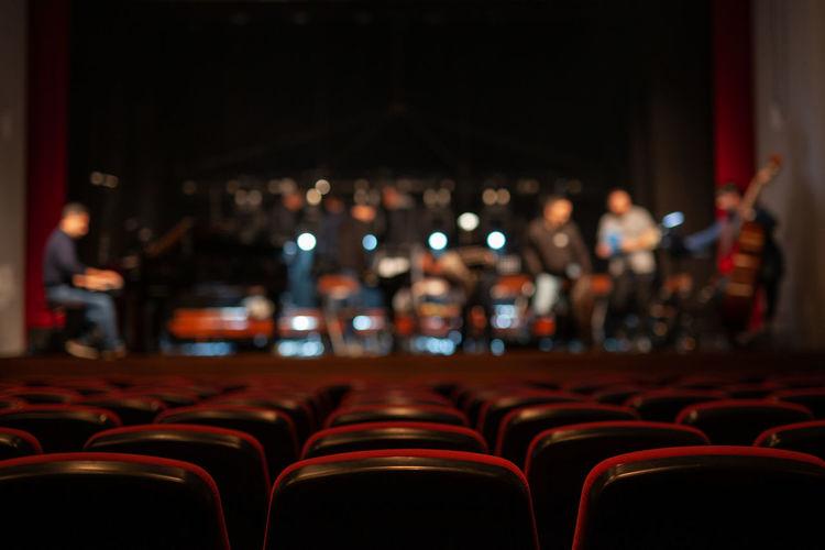 Men on stage in auditorium