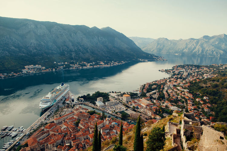 Cruise ship sailing in Bay of Kotor, mountains background. Aerial view. Cruise Ship Kotor Bay Nature Old Town Aerial View Bay Beauty In Nature Cruising Journey Kotor Montenegro Mountain Nature No People Outdoors Picturesque Travel Destinations Water