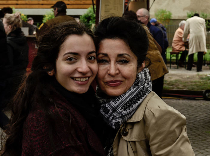 Portrait of smiling young woman with mother