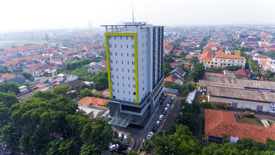 large buildings in dense settlements Built Structure Architecture City Building Exterior Building High Angle View Tree Cityscape No People Nature Tower Day Plant Communication Street Outdoors Sign Text Residential District Transportation Office Building Exterior Skyscraper Surabaya Surabaya City Metropolis