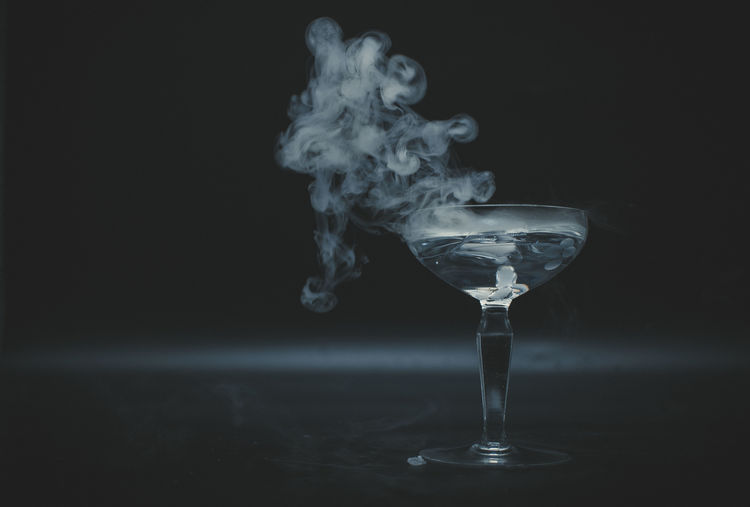 Close-up of smoke emitting from glass