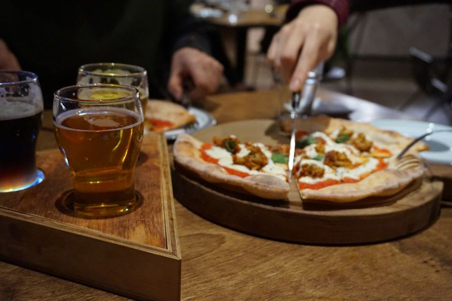 Together With Family Beer Glass Wood - Material Beer Pizza Food And Drink Table Pizza Food Human Hand One Person Indoors  Drink Close-up Ready-to-eat Alcohol Food Stories