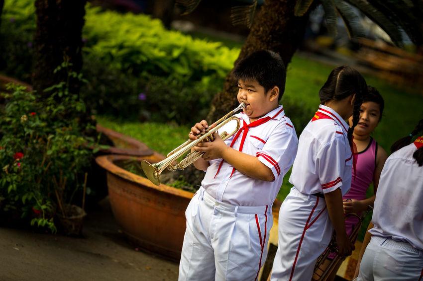 Boys Brass Brass Band Culture Girls Ho Chi Minh City Kids Lifestyles Music Musician Outdoors Practising Saigon Teenager Trumpet Uniform Uniforms Vietnam Vietnamese