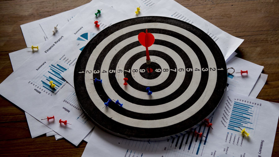 Setting goals for business success and commercial concepts Sports Target Accuracy Sport Indoors  Circle Geometric Shape Close-up Success Leisure Activity Shape No People Paper Skill  Target Shooting Table Number Arrow - Bow And Arrow Competition High Angle View