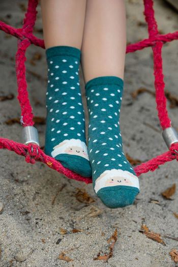 Low Section Human Leg One Person Human Body Part Body Part Shoe Women Day Child Real People Leisure Activity Childhood Adult Girls Lifestyles Outdoors Close-up Polka Dot Focus On Foreground Human Foot Sock Human Limb