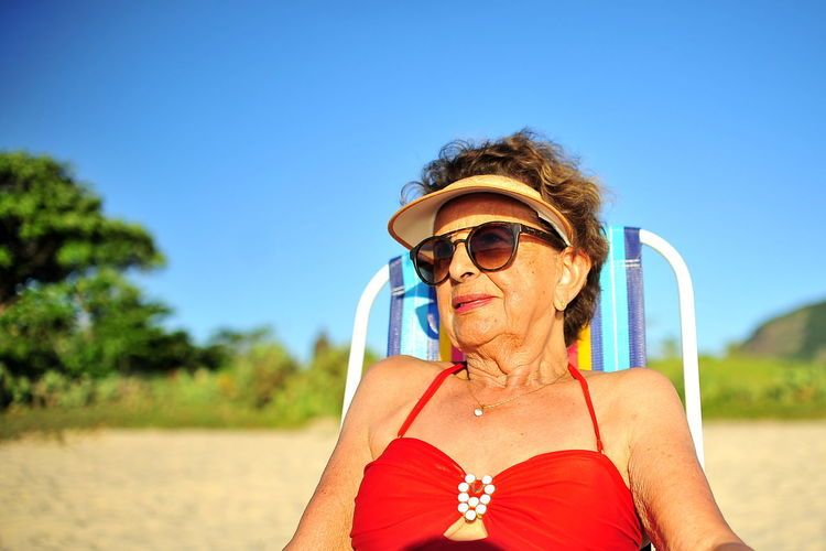 EyeEm Best Shots A New Beginning Adult Beach Eye4photography  Fashion Getting Inspired Glasses Hairstyle Headshot Lady In Red Leisure Activity Mature Adult One Person Outdoors Portrait Real People Senior Adult Senior Women Sunglasses Sunlight Women 50 Ways Of Seeing: Gratitude This Is Natural Beauty Springtime Decadence The Portraitist - 2019 EyeEm Awards